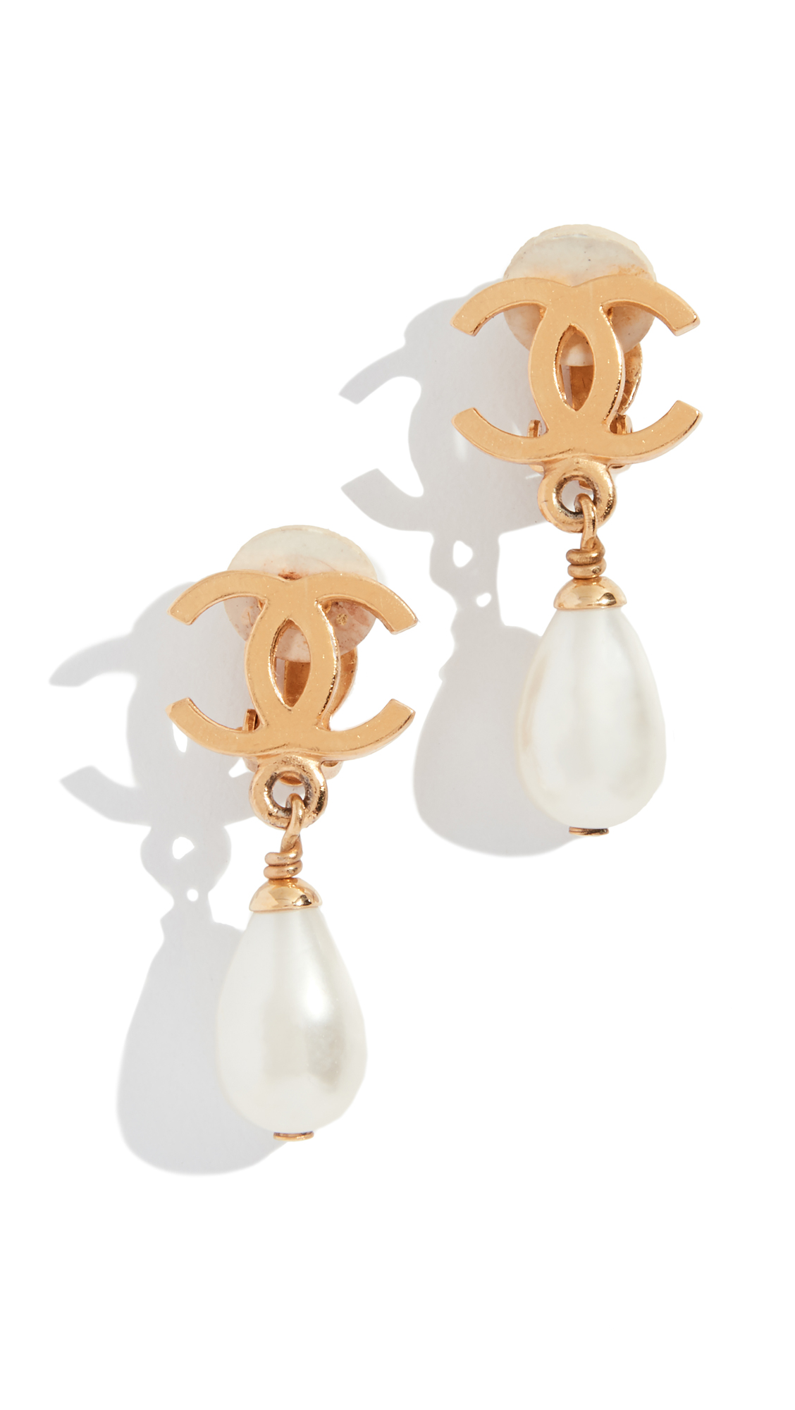 WHAT GOES AROUND COMES AROUND Chanel Dangle Clip On Earrings in Gold