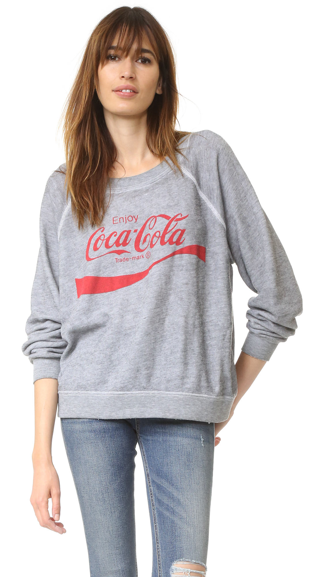 A Coca Cola graphic adds a classic touch to this super soft fleece Wildfox sweatshirt. Overlock stitches accent the raglan seams. Banded edges. Long sleeves. Fabric: Fleece. 50% polyester/47% cotton/3% rayon. Hand wash. Made in the USA.