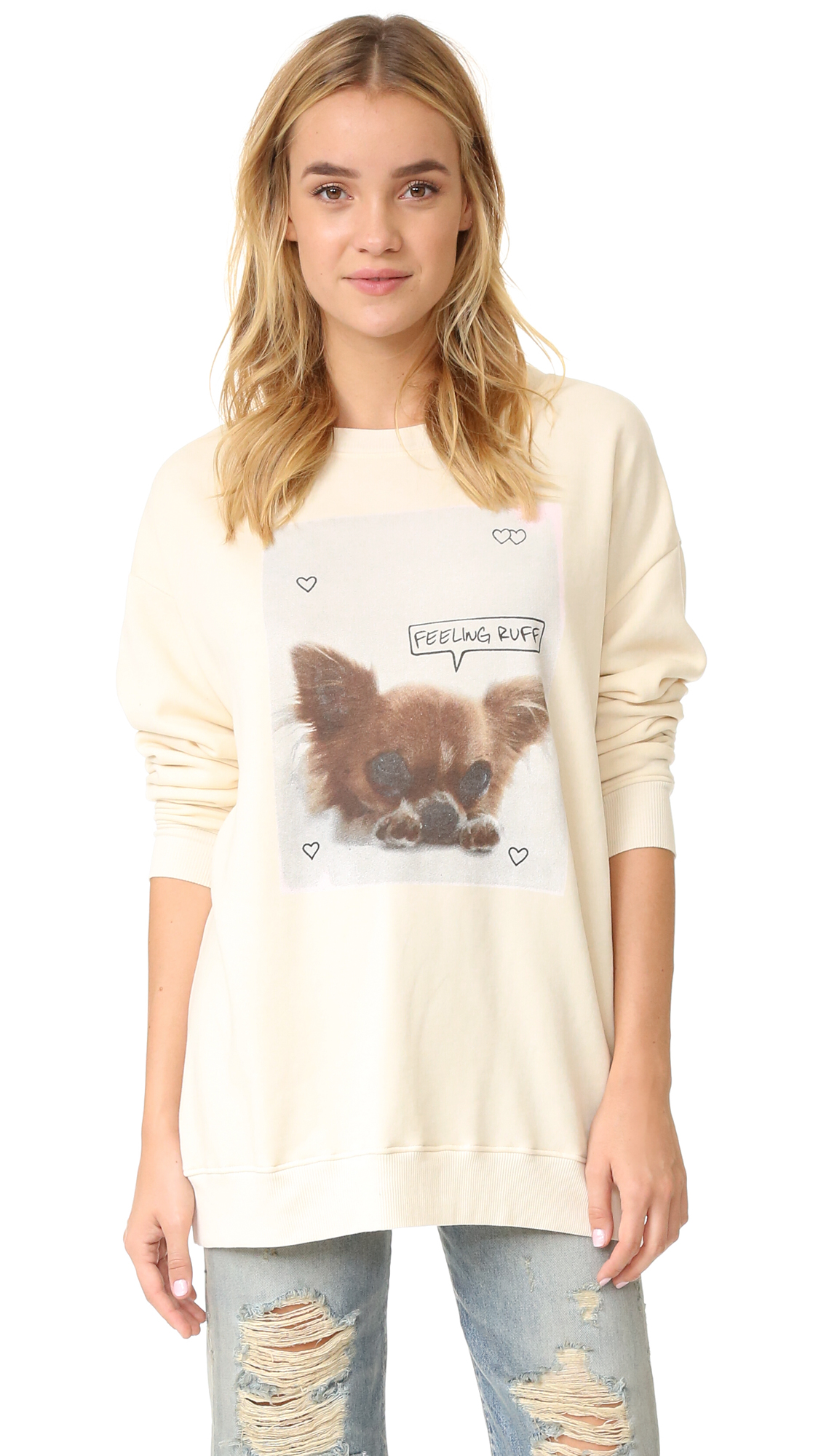 An oversized Wildfox sweatshirt composed of plush fleece. A sad puppy photo design with 'Feeling Ruff' lettering details the front. Banded edges. Long sleeves. Fabric: Fleece. 70% cotton/30% polyester. Hand wash. Made in the USA. Measurements Length: 28.75