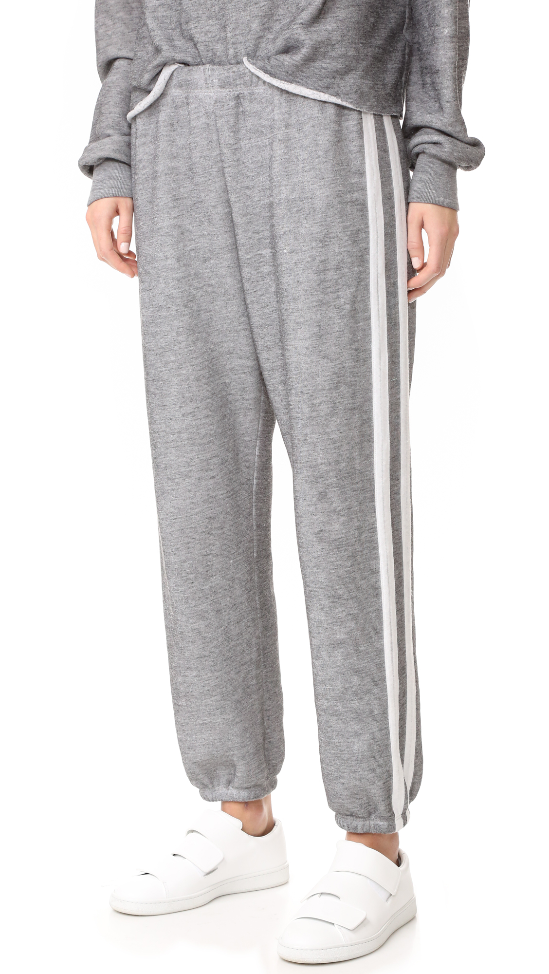 Contrast stripes accent these slouchy Wildfox sweatpants. Gathered elastic cinches the waist and cuffs. Fabric: Fleece. 50% polyester/47% cotton/3% rayon. Wash cold. Made in the USA. Measurements Rise: 11in / 28cm Inseam: 29.25in / 74cm Measurements from size S.