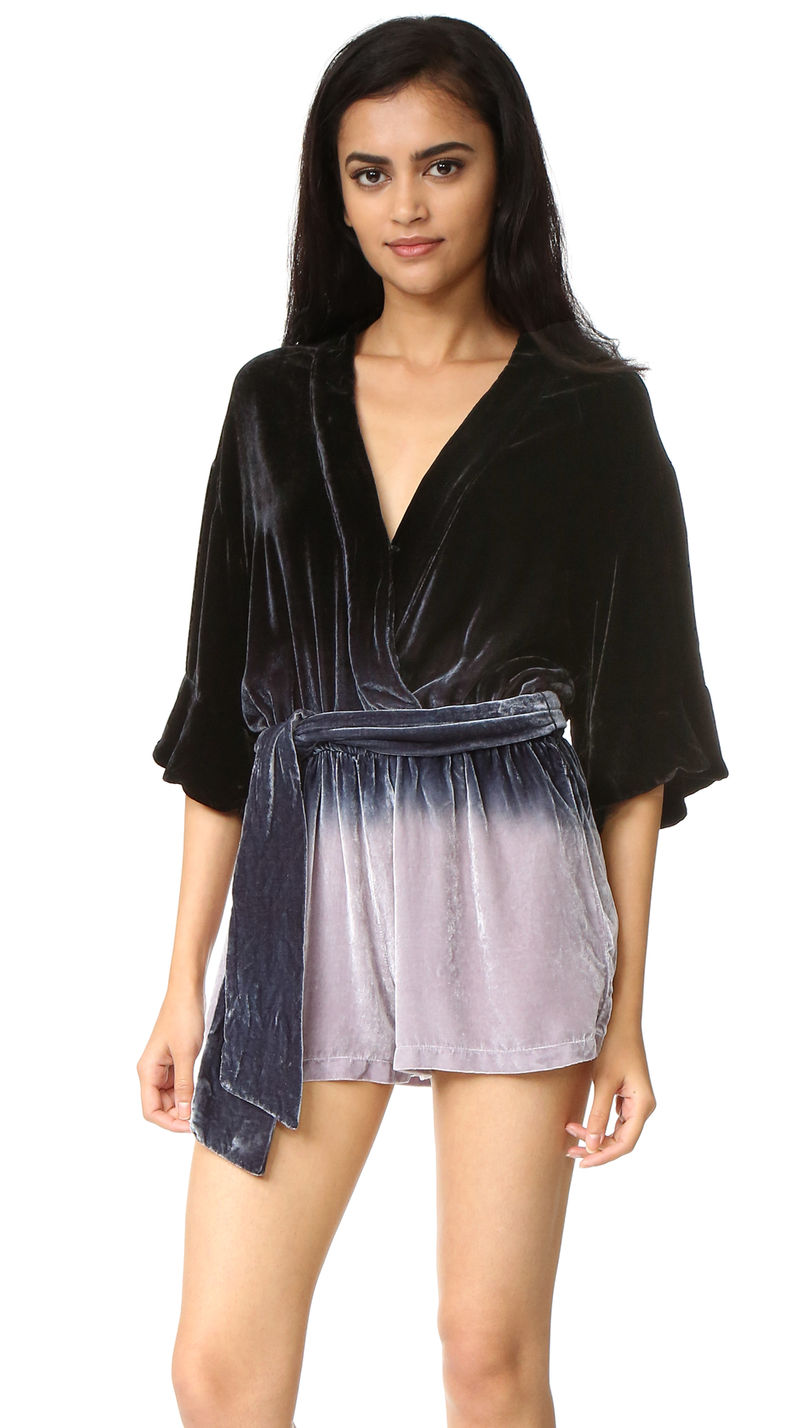 A relaxed Young Fabulous & Broke romper, composed of rich velvet in a striking ombré wash. A hook and eye closure secures the crossover V neckline, and a self belt ties at the covered elastic waist. Elbow