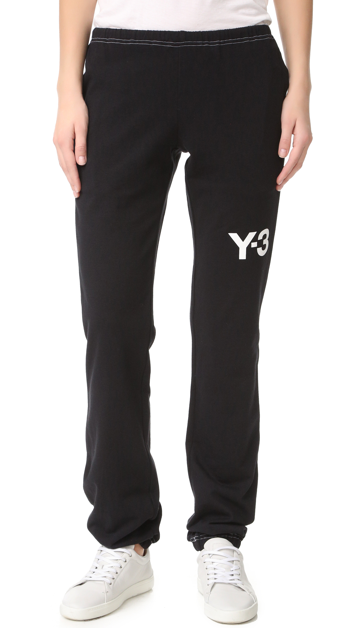 Straight leg Y 3 sweatpants with contrast topstitching and logo letters at the side. On seam pockets. Drawstring waistband and elastic cuffs. Fabric: French terry. 100% cotton. Wash cold. Imported, China. Measurements Rise: 8.75in / 22cm Inseam: 33.75in / 86cm