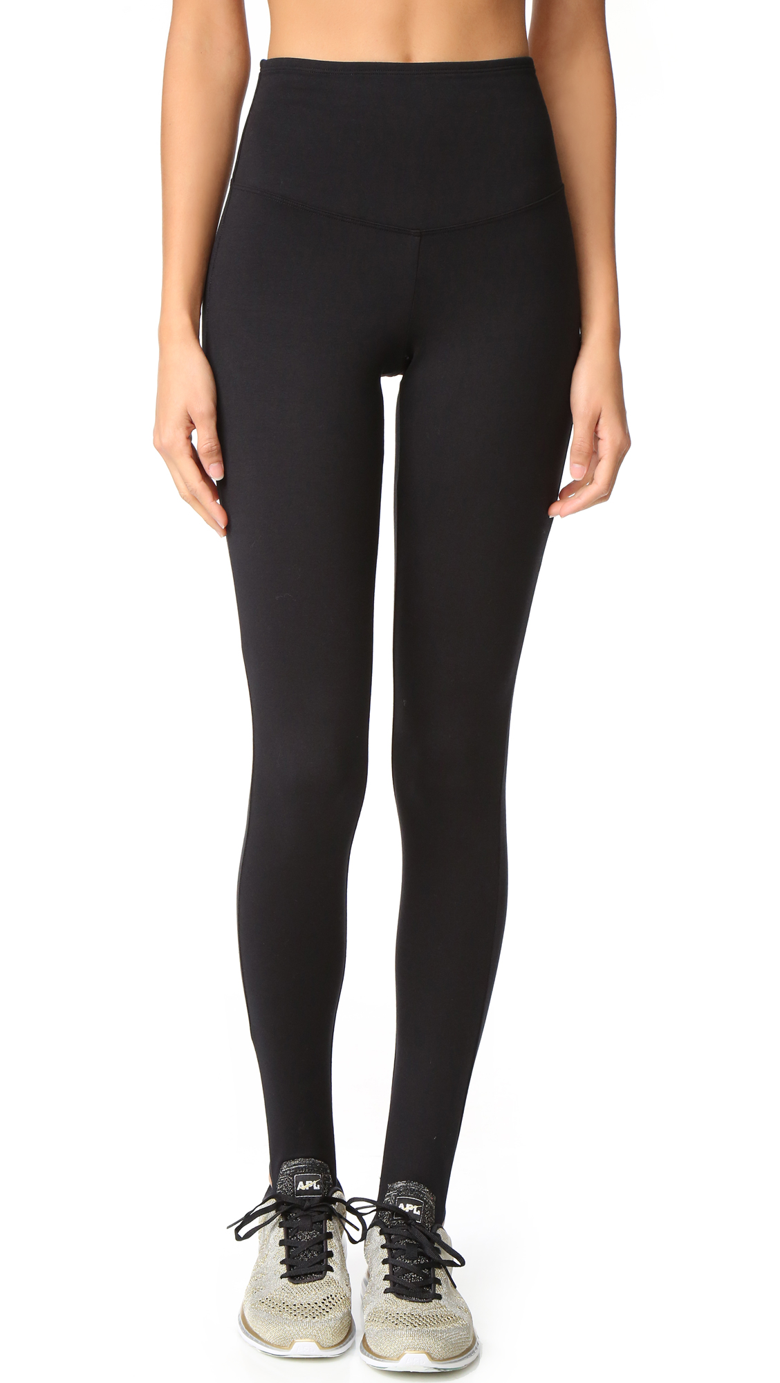 Classic stirrup leggings, composed of mid weight jersey and styled with a high rise. Double layer waistband for a smooth fit. Fabric: Mid weight jersey. 88% cotton/12% spandex. Wash cold. Imported, China. Measurements Rise: 10.75in / 27cm Inseam: 29.5