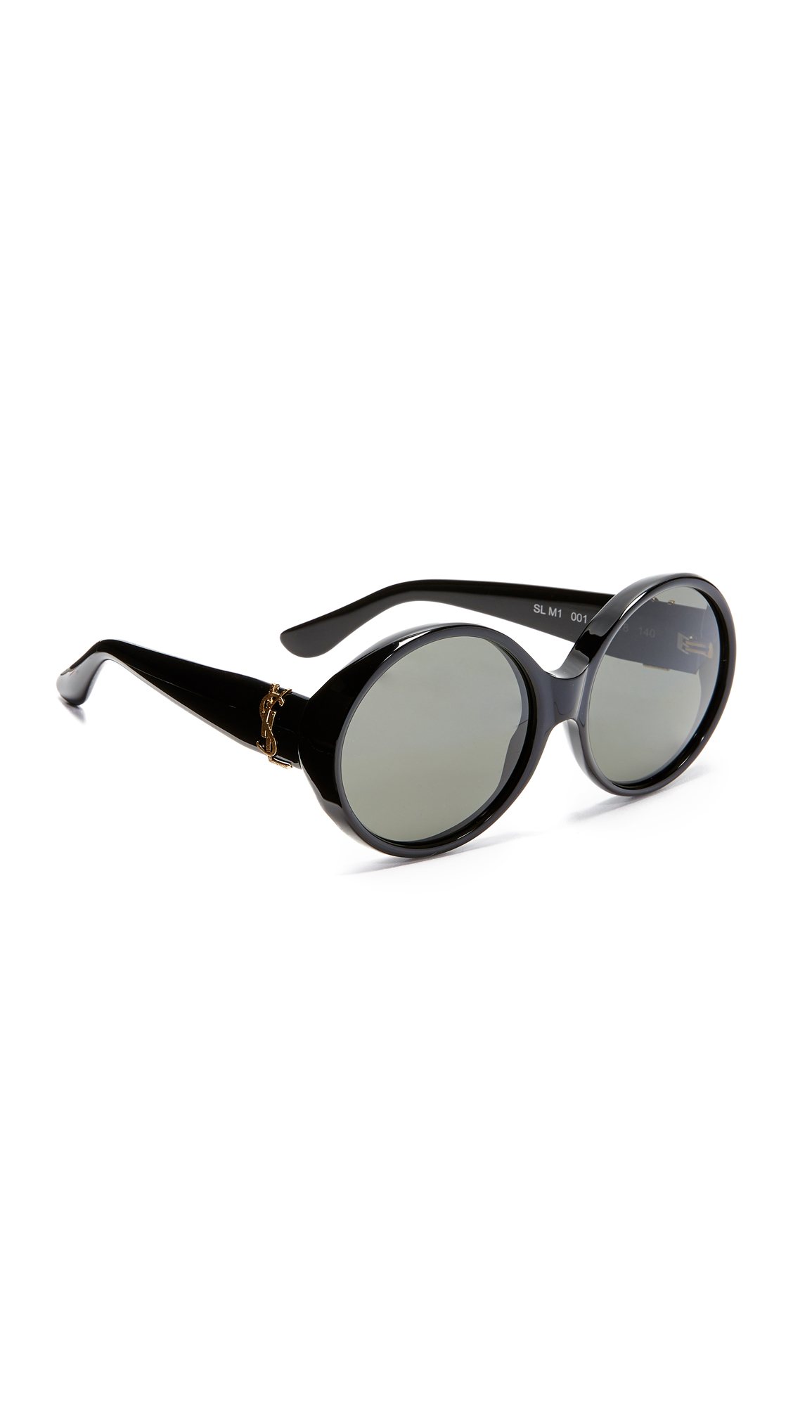 These sleek, vintage inspired Saint Laurent sunglasses have oversized, round lenses and engraved gold tone YSL lettering at the temples. Structured magnetic case and cleaning cloth included. Round frame. Non polarized lenses. Made in Italy. Measurements