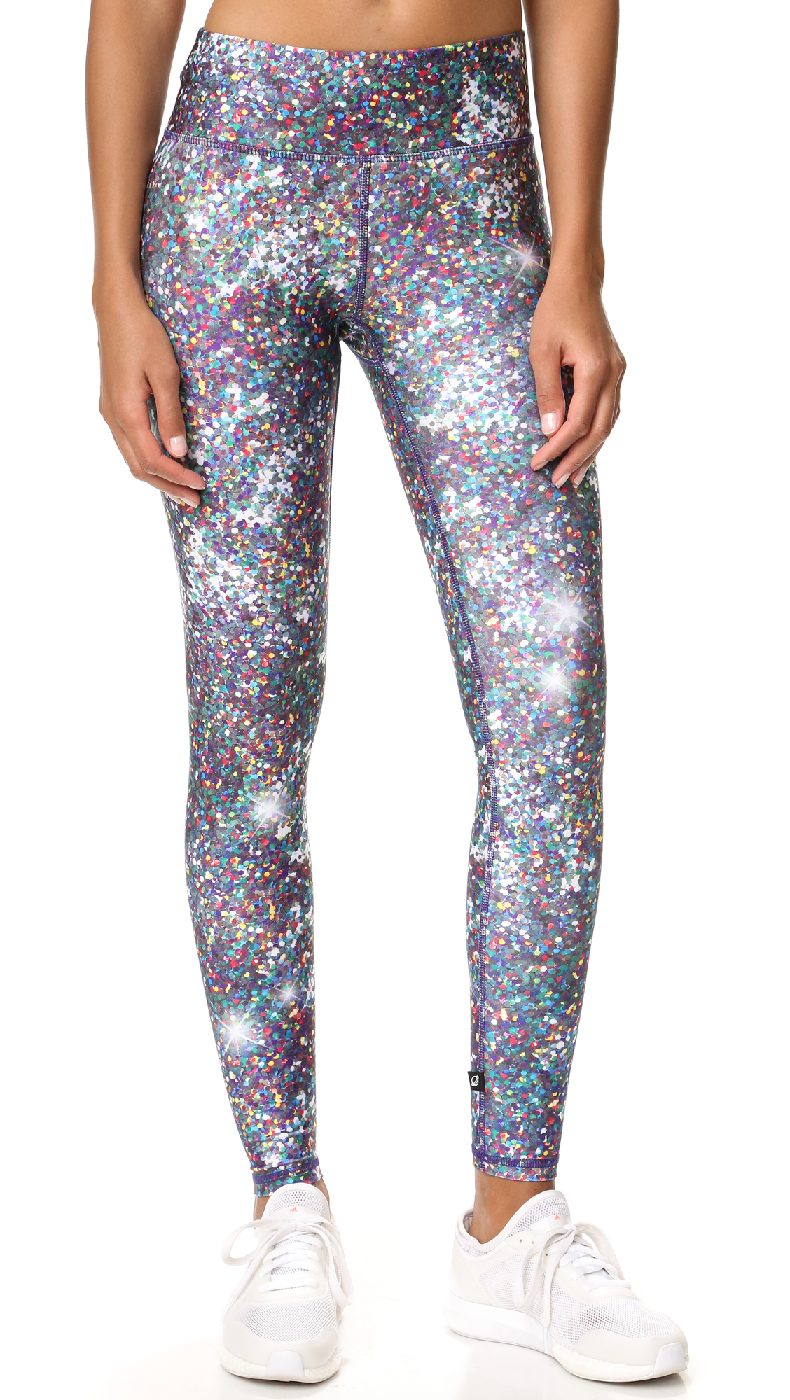 These high rise Terez leggings have a glamorous glitter print. Covered elastic waistband. Fabric: Activewear jersey. 80% polyester/20% spandex. Wash cold. Made in the USA. Measurements Rise: 9.5in / 24cm Inseam: 28in / 71cm Measurements from size S. Available