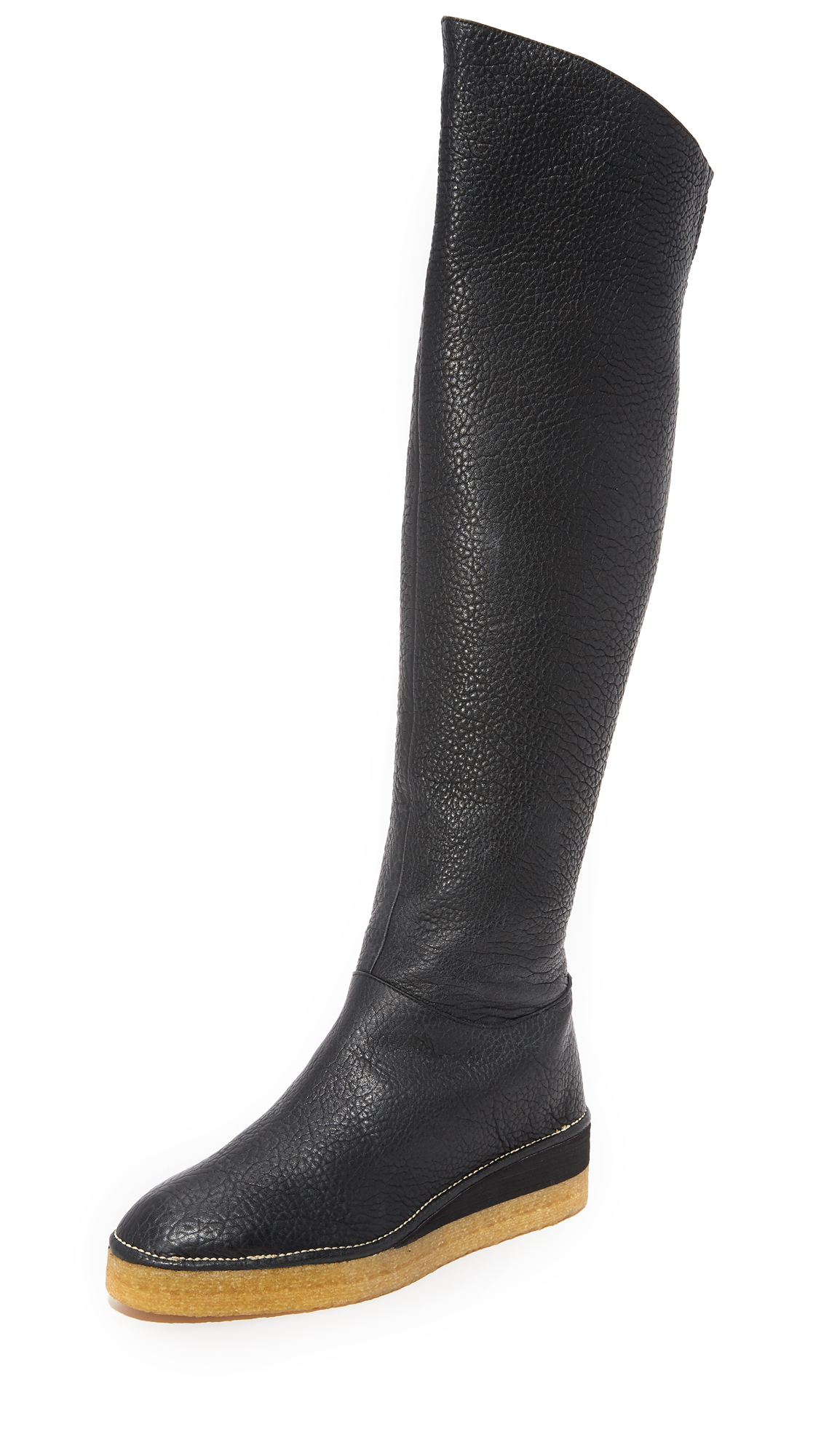 Rich, pebbled leather Zero + Maria Cornejo boots styled with a sculpted top line. A hidden zip secures the ankle and elastic insets relax the shaft. Foam platform and crepe sole. Leather: Lambskin. Made in Italy. Measurements