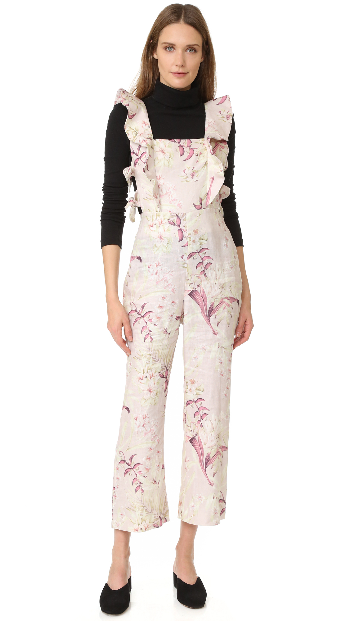 Description NOTE: Zimmermann uses special sizing. Please see Size & Fit tab. A pastel floral print brings soft, feminine style to this crisp linen Zimmermann jumpsuit. Knots cinch the cutout bodice, and flirty ruffles trim the shoulders.