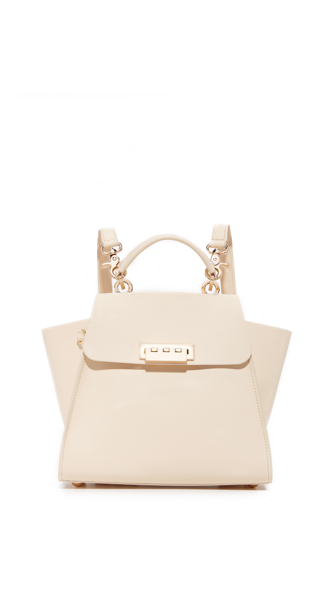 This structured ZAC Zac Posen bag can be carried as a shoulder bag or worn as a backpack. A turn lock fastens the top flap, which opens to a leather lined, 1 pocket interior. Top handle and