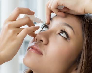 Woman using eyedrops