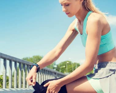 Woman runner tightening knee brace