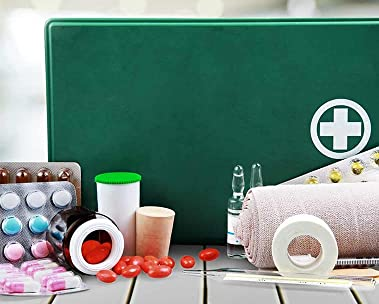 Green first aid kit with supplies laid out