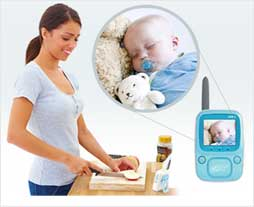 Infant Optics DXR-5 monitors baby while mother makes a meal