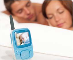 Infant Optics DXR-5 monitors baby while couple sleeps