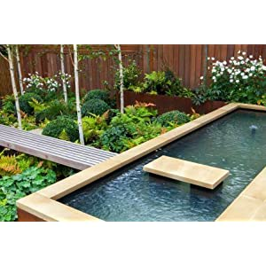 realised through the use of different features and materials the powerful lines in this design create a dramatic picture with the clean shapes of the - Garden Design Contemporary