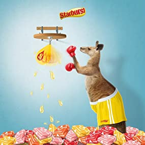 Boxing Kangaroo punches original strawberry, cherry, orange, and lemon Starbursts from a bag