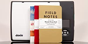 doxie flip standing on its side with a variety of field notes notebooks in front of it
