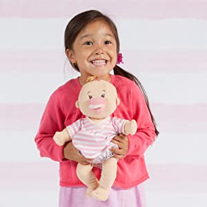 Baby Stella, first soft doll, girl with doll, first baby doll