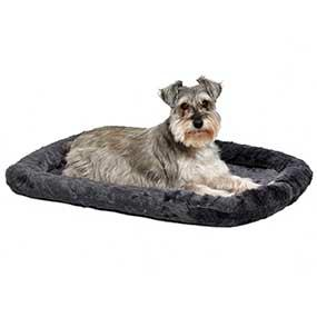 Dog in Gray Bed