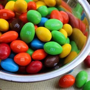 Pour a large or sharing size bag of M&M'S Almond Chocolate pieces in your candy dish.
