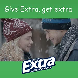 Give EXTRA, get extra. Sharing special moments with others. Loving couple in snow.