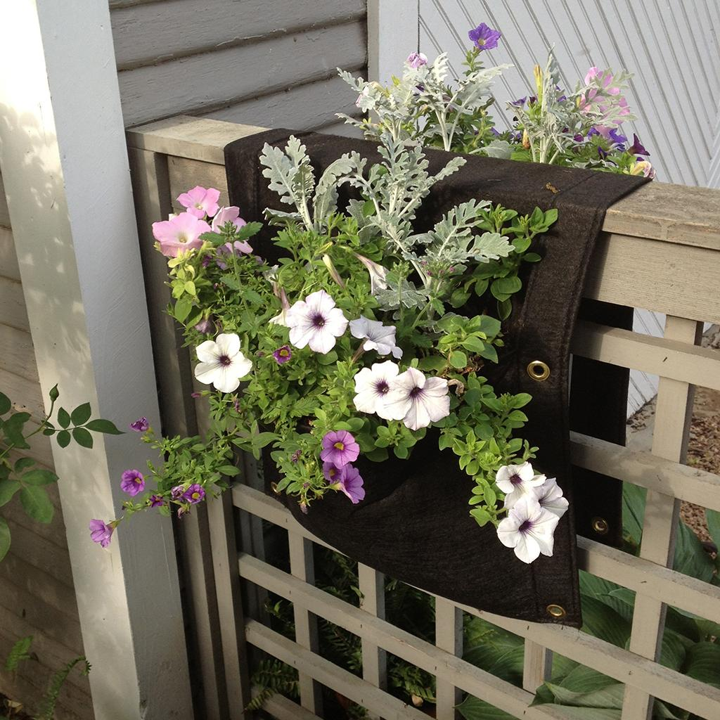 Smart pots wall flower saddle planter for Outdoor wall flowers