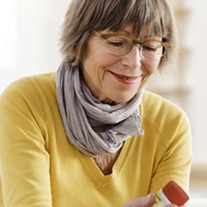 Woman holding a Tylenol bottle