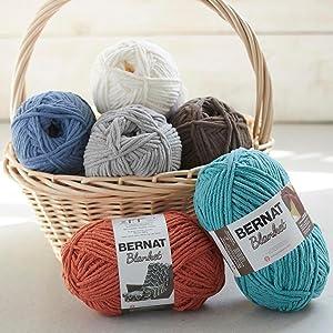 Bernat Yarn;yarn in basket;multiple shades