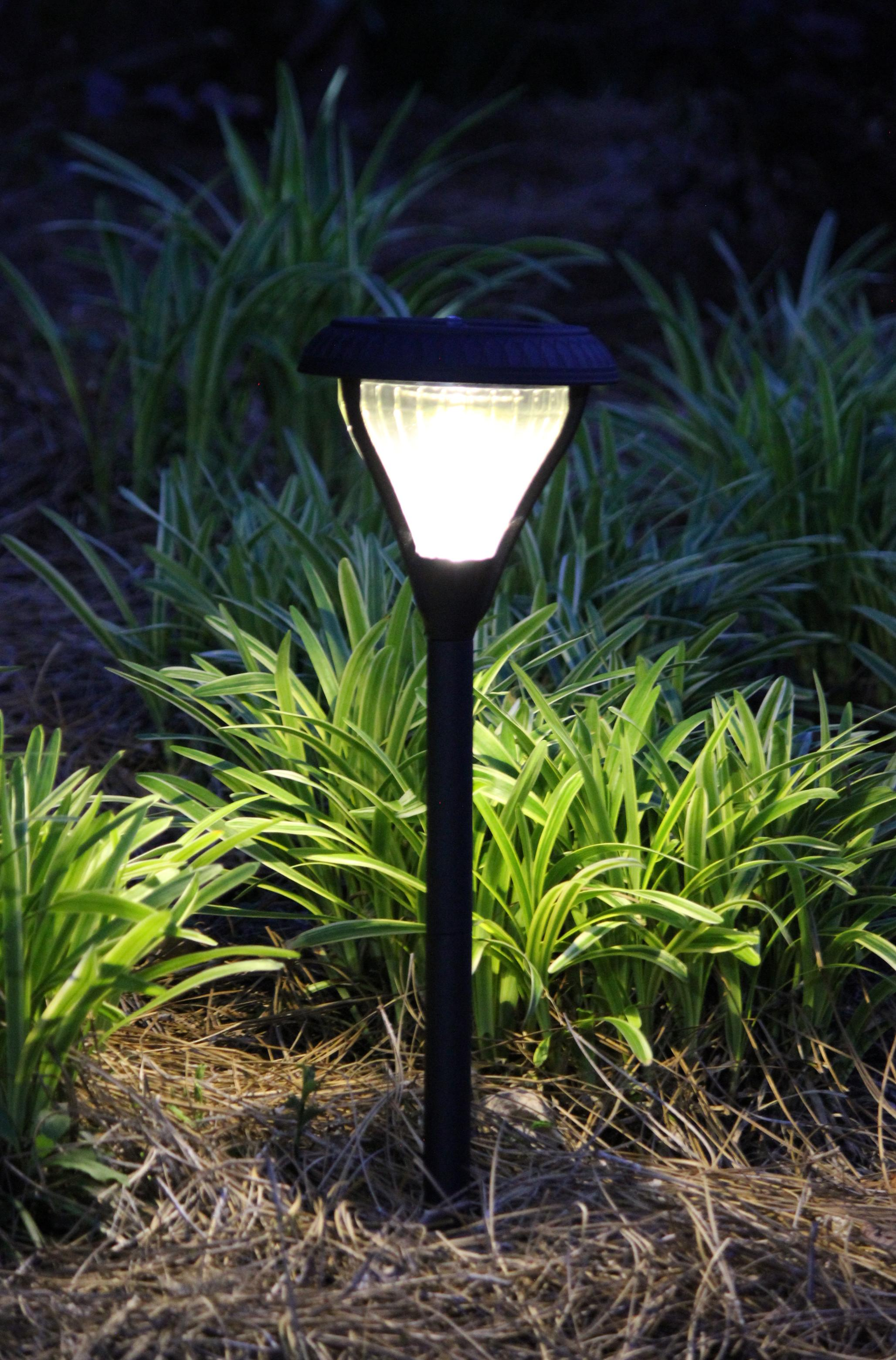 gama sonic premier solar garden and path light outside at night - Solar Landscape Lights