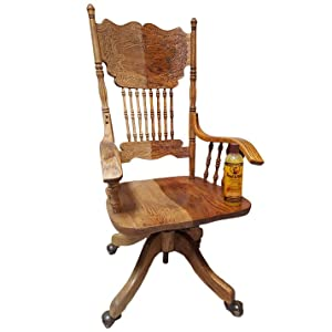 Howard Feed-N-Wax Furniture Polish and Conditioner on a wooden rocking chair.