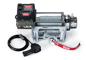 Warn Industries 26502 M8000 8000-lb self-recovery winch showing the inner workings of the drum, geartrain and clutch
