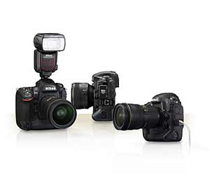 Photo of a trio of Nikon D4s cameras, one with a Speedlight flash attached, one with an Ethernet cable attached and one with the WT-5A attached