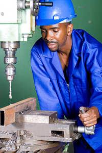 man operating drilling machine in bright light
