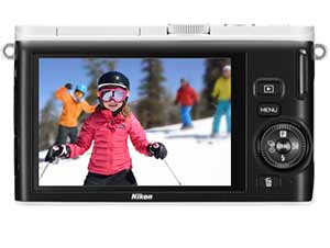 Photo of a kid skiing on the rear LCD of a Nikon 1 J4 highlighting technology