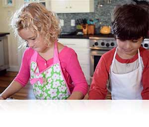 Nikon 1 J4 photo of two kids baking in a kitchen highlighting Full HD video