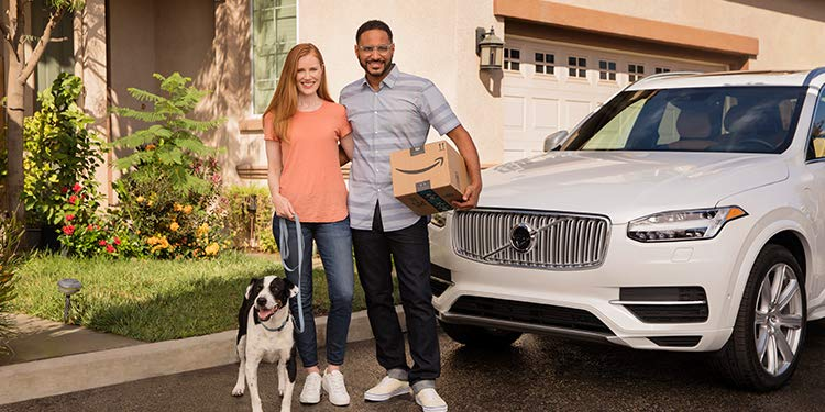 Customers with their dog and package next to car