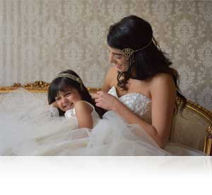 Candid photo of a bride and flower girl shot with the steady AF-S NIKKOR 24-70mm f/2.8E ED VR lens