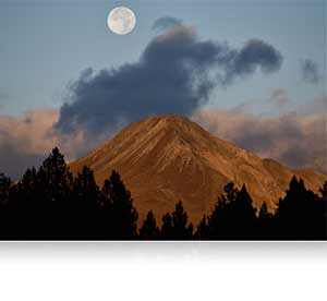 Landscape photo of the full moon over a mountain shot using the AF-S NIKKOR 300mm f/4E PF ED VR lens