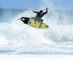 Nikon photo of a surfer above the waves shot with the AF-S NIKKOR 500mm f/4E FL ED VR showing VR image stabilization