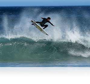 Nikon Photo of a surfer above a wave shot with the AF-S NIKKOR 500mm f/4E FL ED VR lens showing durability