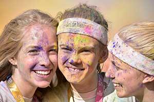 photo of 3 women, shot with AF-P DX NIKKOR 70-300mm f/4.5-6.3G ED VR, highlighting zoom range