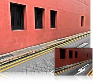 Nikon A900 photo of a red wall and cobblestone street inset with another view of the photo highlighting creative options