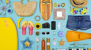 Nikon D3400 among summer beach items showing compact size