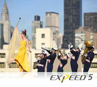 Nikon D5 DSLR photo of a marching band and EXPEED 5 logo showing Nikon processing power