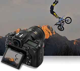 Nikon D500 DSLR photo of a stunt biker in air inset with the camera and photo on the lCD