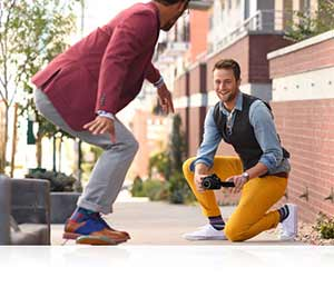 Nikon D5500 photo of a man photographing another man on a skateboard highlighting the Vari-angle LCD