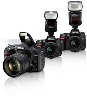 Three Nikon D610 cameras with lenses and Speedlights showing flash compatibility.
