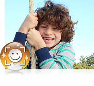 Nikon COOLPIX L32 photo of a boy climbing a rope and the Face Priority AF icon inset showing the Smart Portrait System