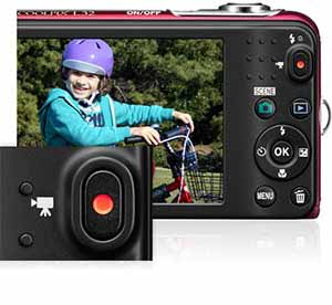 Nikon COOLPIX L32 photo of a girl riding a bike in a park inset with the video button showing easy HD video capture