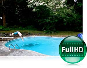 Photo of a kid diving into a pool, and the Full HD icon showing the COOLPIX L620's video capabilities
