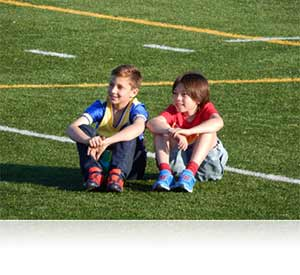 Nikon COOLPIX L830 photo of two boys sitting on a soccer field showing ease of use